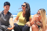 Sharing a laugh with friends at the beach is a great way to enjoy your English study